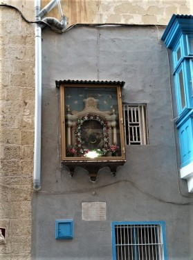 Religious iconography embedded in buildings